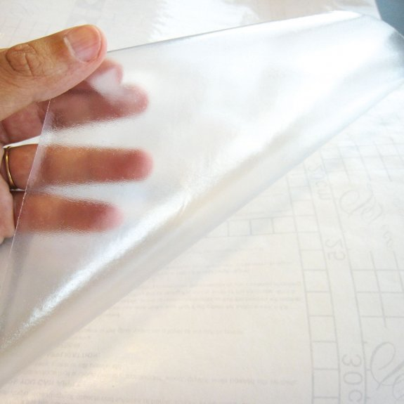 Dekorplast transparent för laminat